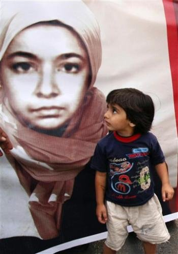 Child Looking at Afia's Poster